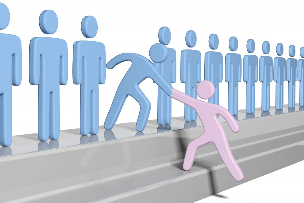 image of Member gives a hand up to help new person join social group or business team