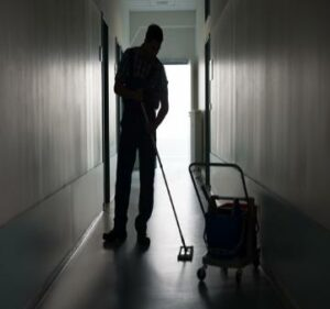 man washing floor