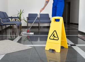 image of person cleaning floor in office